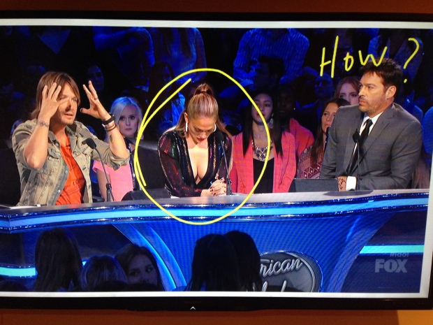J-Lo hypnotized Harry with her boobs o so bad he couldn't help himself.